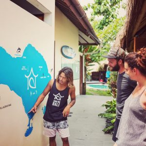 A surf guide showing our SurfWG bali Surf camp plan to guests at our surf school Bali