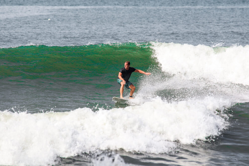 SurfWG surf camp Bali guest riding a wave