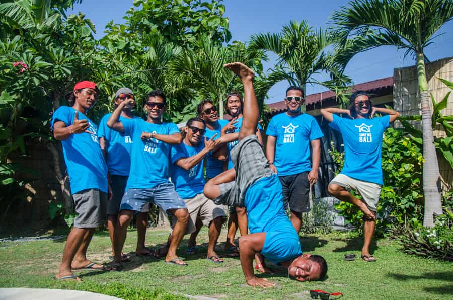 SurfWG surf camp guides with blue SurfWG shirts making fun