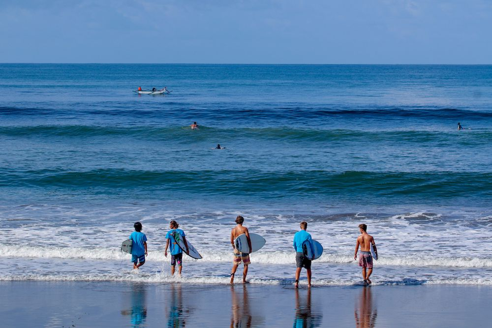 SurfWG Bali surf camp surf guides with guests checking waves