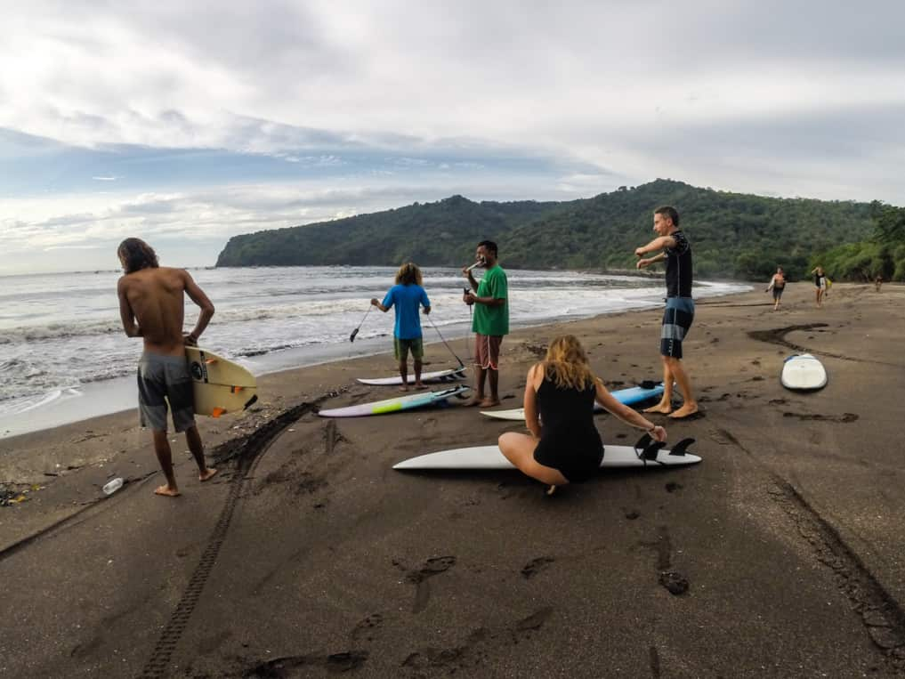 Group of surfers from SurfWg bali surf camp preparing the surf in java